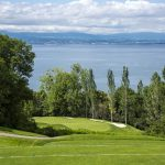 Pink flagsticks complement the lush emerald greens of Evian Resort Golf Course